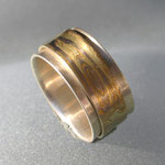 """Basisring aus Silber mit frei beweglichem """"Spielring"""" aus 15schichtigem MokuMeGane 750er Gelbgold, 750er Weißgold und Silber"""