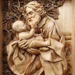 Иосиф с младенцем Иисусом - резное деревянное панно. Оформлена в раму под стекло. Материал: липа.  Художник-резчик по дереву: Байков Михаил.