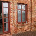 Blick aus dem Wohnraum Ferienwohnung 2 am Scheunentor auf die Terrasse