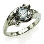 Rock Ring. Palladium white gold using client's diamonds on either side of a pale blue sapphire.