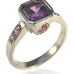 14 karat palladium white gold, purple sapphire, rubies and pink sapphires.  Check out the process!
