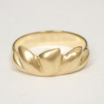Custom yellow gold lotus ring with matte finish.