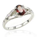 Custom white gold ring with garnet.
