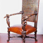 18th century French chair with new leather before leather refinish and restoration of inside embossed leather back.