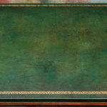 Created antiqued green leather card table top with distressed gold tooling