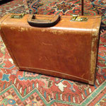 An auction house president's briefcase prior to restoration