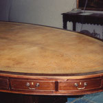 Before Restoration: Damaged oval 16 ft. leather conference table