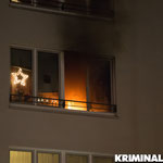 Flammen und Rauch kommen aus dem Fenster.|Foto: Christopher Sebastian Harms