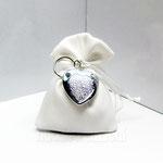 sacchetto in taftà panna interno in raso con portachiavi  € 5,00
