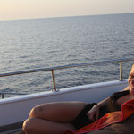 Bettina relaxing and dreaming on the front deck of Blue Waves