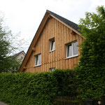 TISCHER Tischlerei: NUR-HOLZ-Haus Lärchenholzfassade