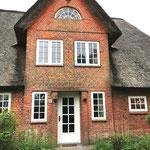 Haustür aus Holz mit Sprossenteilung und Einzelverglasung nach vorhandener Tür gefertigt