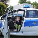 im Polizeiauto