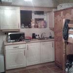 Unser Zimmer mit eigener Küche.