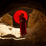 Novice monk with red parasol in Nyaung U, Myanmar     © Stephan Stamm