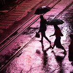 People crossing a road in Yangon at a rainy evening, Myanmar     © Stephan Stamm