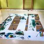 Eindrücke vom Kita-Workshop 'Experimentelle Malerei' mit essbarer Farbe aus eigener Herstellung