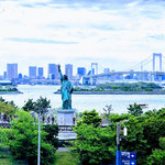 A View of a Statue of Liberty and Rainbow Bridge in Odaiba.