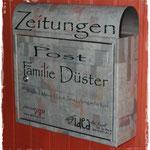Briefkasten mit Familenname und Logo