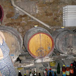 Maria and the barrels into which the wine will go once the juice has fermented