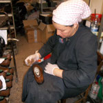 Polishing the finished leather shoes