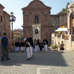Religious procession with Sant'Agostino church in the backgrond