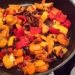…add peppers and wait for the onion to caramelize