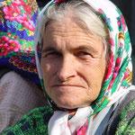 Marktfrau in Prizren, Oktober 2001 © Robert Hansen. Link in die Fotogalerie