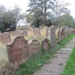 Resited gravestones along the south path