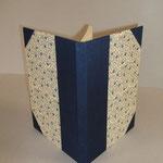 """Libro-Agenda """"le mie poesie"""". Dorso ed angoli in tela blu, piatti in carta tipo """"Varese""""."""