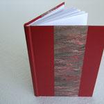 Legatura fogli singoli in mezza pelle con carta marmorizzata