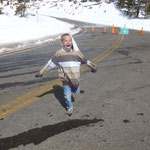 Caleb running on the road to Pike's Peak