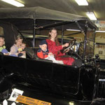 Sitting in a Model T Ford at a museum in Clyde, Kansas