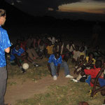 Outreach in the North: after the sports, we share the gospel with the young people. The players are comprised of Christians, Muslims, and Animists