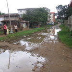 Dirt road from our house leading to main road (rainy season)