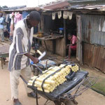 Man selling sugar cane for about 10 cents/stick