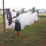 washing table cloths and hanging them to dry