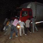 The thunderstorm held off just long enough to unload all of our stuff. But the truck driver didn't fare so well. With the help of many people, he finally unlodged the truck from the wet sand around 10pm.