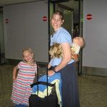Caleb rode African style on Cindy's back through the airports