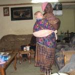 Hannah holding Elijah Nigeria style