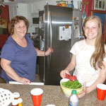 Jillian and Ann DiSanza, cooking in the kitchen