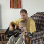 Teaching Naomi guitar