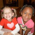 Naomi & Toluani - childhood friends - both born in Port Harcourt, Nigeria