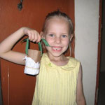 Emily lost a tooth.  Her sisters made a carrying bag out of an old toilet paper roll.