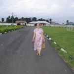 This is the road inside of the gate of the YWAM compound.  Cindy is on her way back to the guest house from a day in Aba.