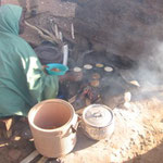 Woman making Masa, a traditional Hausa food.