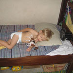 Caleb sleeping on his bed