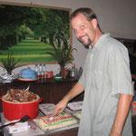 Eric cuts the cake