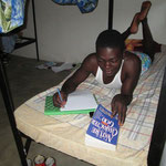 A student studying in his room