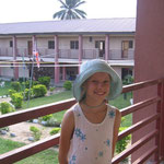 Jillian standing on the walkway overlooking the courtyard outside of our dorm rooms.
